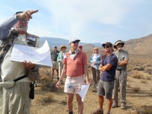 Terry Wright points out key geologic features of the Owens Valley to tour participants.