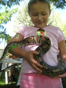 A young veterinarian in training holding a snake that was probably longer than she was tall.