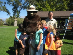 A group of Smokey the Bear fans pose for a photograph.
