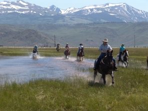 Riders at the Hunewill Guest Ranch