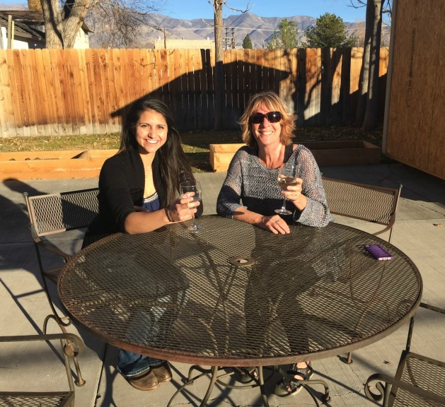 Mini and Kay enjoying a glass of wine in the backyard at the end of a long workweek!