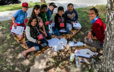 Here, Sara leads a learning activity to teach a group of third graders about how bees and butterflies are keeping the Eastern Sierra blooming.
