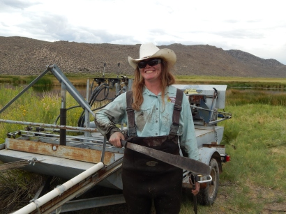 Sus Danner, proudly wielding her home-improved, sawed-off banana machete: the perfect tool for removing even the most stubborn cattail!