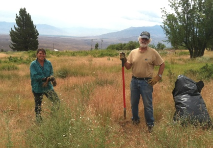 """""""I love the heavy work of pulling, cutting, and rolling up fences to remove barriers to sage-grouse roaming, especially on such a gorgeous landscape... And a bonus is working with a very delightful group of volunteers."""" - Wally Woolfenden (right), Stewardship Volunteer with ESLT"""