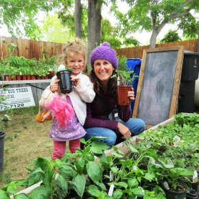 At GardenFest, a mother and child purchase plants