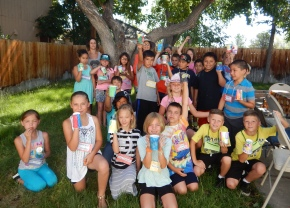 Kids in Victoria Hamilton's 3rd grade Bishop Elementary School Class proudly show off their painted flower pots at their Garden Party.