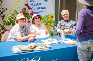 At the Master Gardeners table, gardening tips – and many laughs – were shared. Roberta Lagomarsini, Edie Warkentine, and Erich Warkentine helped answer locals' gardening-related questions.