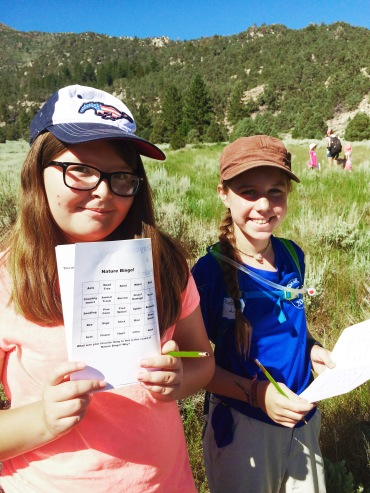 Kiki S. and Robin L. enjoying their afternoon while playing Nature Bingo and learning about the wild world around them.