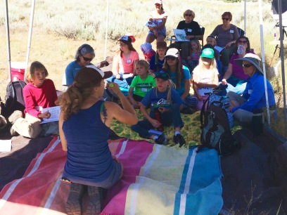 Indigo teaches the group about animal tracks.
