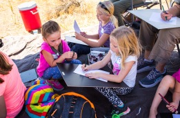 Olivia L, Maya P., and June P. try their hand at sketching what they have seen out on the Preserve. Photo © Amy Leist.