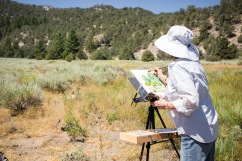 """Local artist Lynn Peterson joined the group to showcase her """"plein air"""" painting techniques, and enjoyed sharing tips with all the budding young artists. Photo © Amy Leist."""